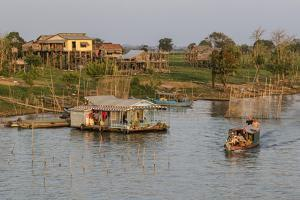 River Family Living on the Tonle Sap River in Kampong Chhnang, Cambodia, Indochina by Michael Nolan