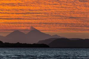 Sunset over Komodo National Park, Rinca Island, Flores Sea, Indonesia, Southeast Asia, Asia by Michael Nolan
