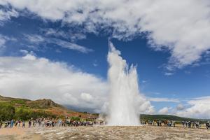 Tourists Gather to Watch Strokker Geyser (Geysir), an Erupting Spring at Haukadalur, Iceland by Michael Nolan
