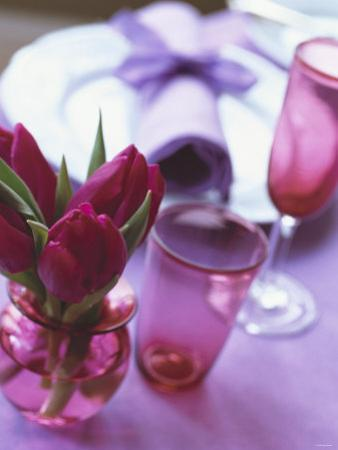 Red Tulips in Small Vase Beside Place Setting by Michael Paul
