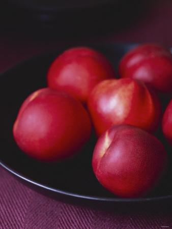 Several Nectarines in a Black Dish by Michael Paul