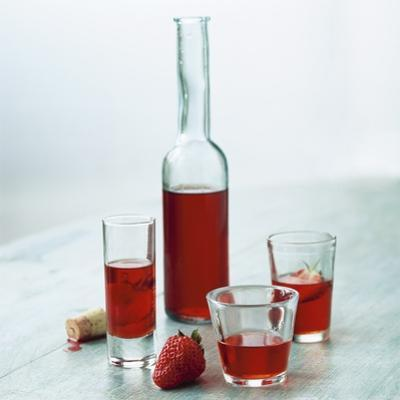 Strawberry Liqueur in Bottle and Three Different Glasses by Michael Paul