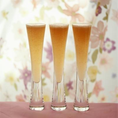 Three Glasses of Bellini (Sparkling Wine with Peach Juice) by Michael Paul