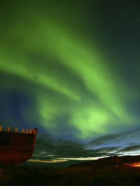 Aurora Borealis or Northern Lights and the Hull of a Wooden Boat by Michael Polzia