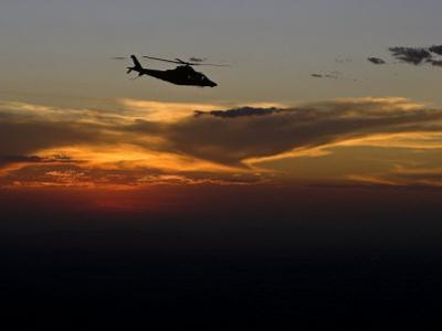 Helicopter Silhouetted Against a Dramatic Sky at Sunset