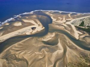 Mouth of a River Creates a Sand Delta on Mozambique's North Coast by Michael Polzia