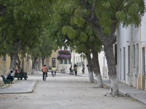 Street Life in an Old Portuguese Village on Ile De Mozambique by Michael Polzia