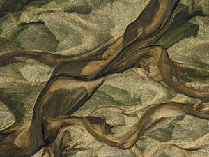 Swirling Patterns of River Runoff Mingling with Coastal Sands by Michael Polzia