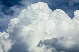 Cumulus Clouds Towering over the Sierra Nevada Mountains by Michael Qualls