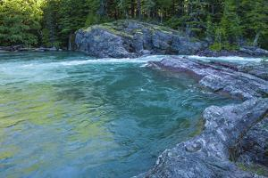 Green Waters of Sacred Dancing Cascade on McDonald Creek, Glacier NP by Michael Qualls