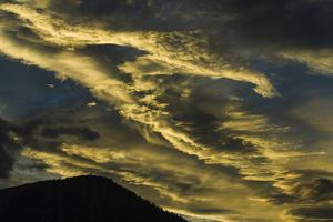 Sunset at Mammoth Lakes California and Wispy, Wind Blown Clouds by Michael Qualls