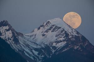 A Full Moon Above the Chugach Mountains by Michael Quinton