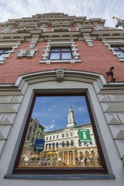 Reflections of Downtown in Shop Window, Riga, Latvia, Europe by Michael