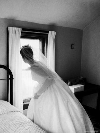 Bride Prepares For Wedding, in Traditional White Gown, 19th Century Wedding Dress by Michael Rougier