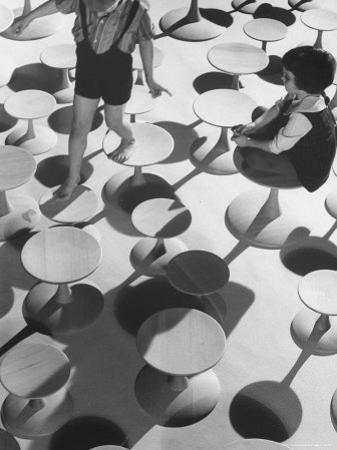 Children Playing Atop Modern Furniture by Michael Rougier