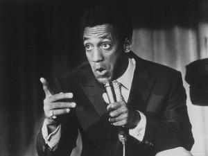 Comedian Bill Cosby Holding Mike as He Performs on Stage by Michael Rougier