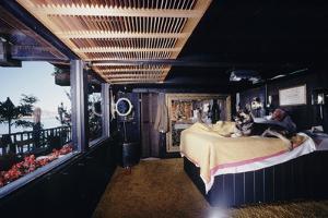Floating-Home Owner Warren Owen Fonslor in His Bedroom, Sausalito, CA, 1971 by Michael Rougier