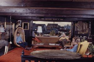Floating-Home Owner Warren Owen Fonslor with Two Men in His Living Room, Sausalito, CA, 1971 by Michael Rougier