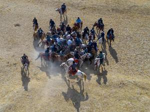 Aerial of a Buzkashi game, Yaklawang, Afghanistan by Michael Runkel