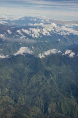 Aerial of the western highlands of Papua New Guinea, Pacific by Michael Runkel