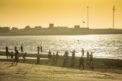 Backlight at Men Playing Soccer at the Beach of Bukha, Musandam, Oman, Middle East by Michael Runkel