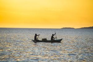 Backlight of Fishermen in a Little Fishing Boat at Sunset by Michael Runkel