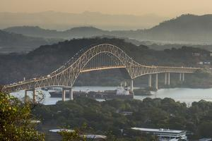 Cargo boat passes the Bridge of the Americas on the Panama Canal, Panama City, Panama, Central Amer by Michael Runkel