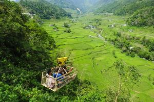 Cargo Lift Transporting People across the Hapao Rice Terraces, Banaue, Luzon, Philippines by Michael Runkel