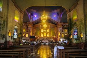 Church Service in the Colonial Spanish Baclayon Church in Bohol, Philippines, Southeast Asia, Asia by Michael Runkel