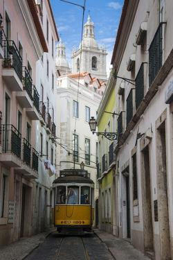 Famous Tram 28 Going Through the Old Quarter of Alfama, Lisbon, Portugal, Europe by Michael Runkel