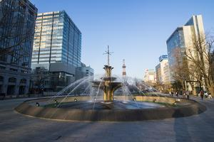 Fountain in the Odori Park, downtown Sapporo at sunset, Hokkaido, Japan, Asia by Michael Runkel