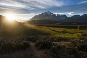 Late Sunrays Breaking Through the Clouds before the Towers of the Torres Del Paine National Park by Michael Runkel