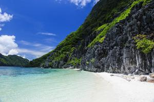 Little White Sand Beach in the Clear Waters of the Bacuit Archipelago, Palawan, Philippines by Michael Runkel