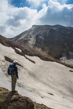 Man Admiring, Mutnovsky Volcano, Kamchatka, Russia, Eurasia by Michael Runkel