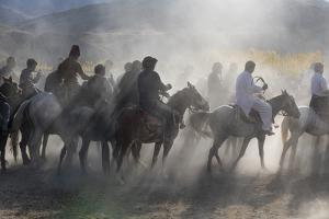Men practising a traditional Buzkashi game, Yaklawang, Afghanistan by Michael Runkel