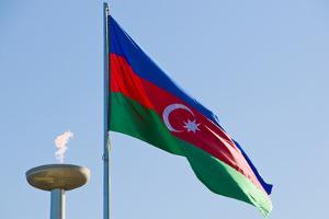 National Flag Blowing in Wind, Baku, Azerbaijan by Michael Runkel