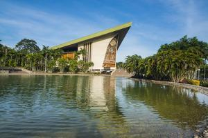National Parliament reflecting in the water, Port Moresby, Papua New Guinea, Pacific by Michael Runkel