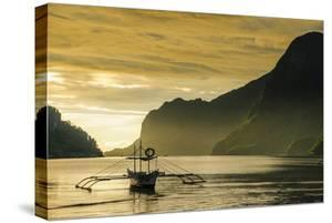 Outrigger at Sunset in the Bay of El Nido, Bacuit Archipelago, Palawan, Philippines by Michael Runkel