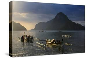 Outrigger Boat at Sunset in the Bay of El Nido, Bacuit Archipelago, Palawan, Philippines by Michael Runkel