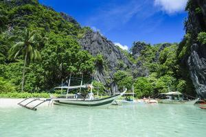 Outrigger Boat in the Crystal Clear Water in the Bacuit Archipelago, Palawan, Philippines by Michael Runkel