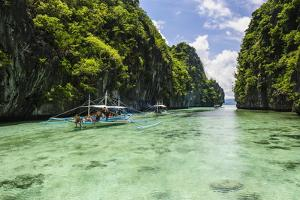 Outrigger Boats in the Crystal Clear Water in the Bacuit Archipelago, Palawan, Philippines by Michael Runkel
