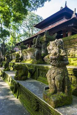 Overgrown Statues in a Temple in the Monkey Forest, Ubud, Bali, Indonesia, Southeast Asia, Asia by Michael Runkel