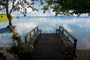 Pier of an Eco Lodge Above the Water of the Marovo Lagoon, Solomon Islands, Pacific by Michael Runkel