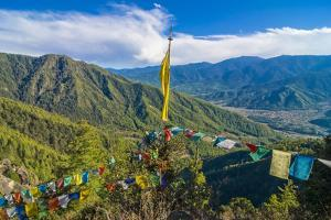 Praying Flags before the Tiger's Nest, Taktsang Goempa Monastery Hanging in the Cliffs, Bhutan by Michael Runkel