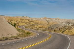 Road Swings Through the Badlands National Park, South Dakota, Usa by Michael Runkel