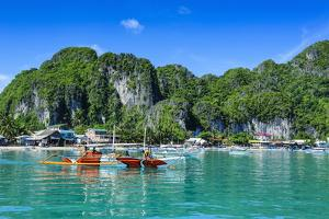 The Bay of El Nido with Outrigger Boats, Bacuit Archipelago, Palawan, Philippines by Michael Runkel