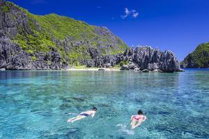 Tourists Swimming in the Crystal Clear Water in the Bacuit Archipelago, Palawan, Philippines by Michael Runkel