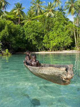 Young Boys Fishing in the Marovo Lagoon, Solomon Islands, Pacific by Michael Runkel