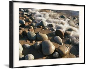 Water Washes up on Smooth Stones Lining a Beach by Michael S Lewis