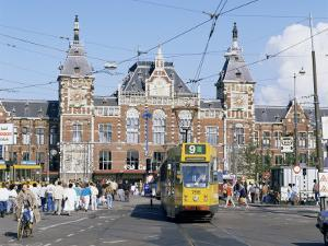 Tram and Central Station, Amsterdam, Holland by Michael Short